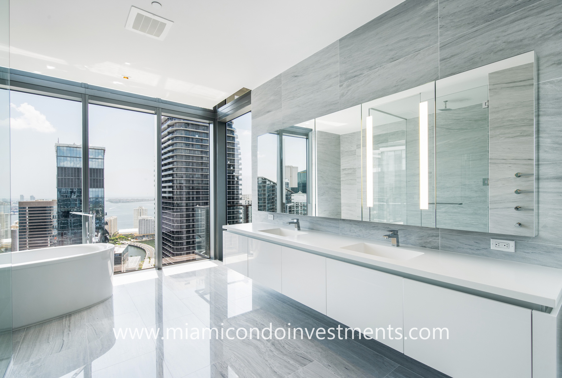 master bathroom with city and water views