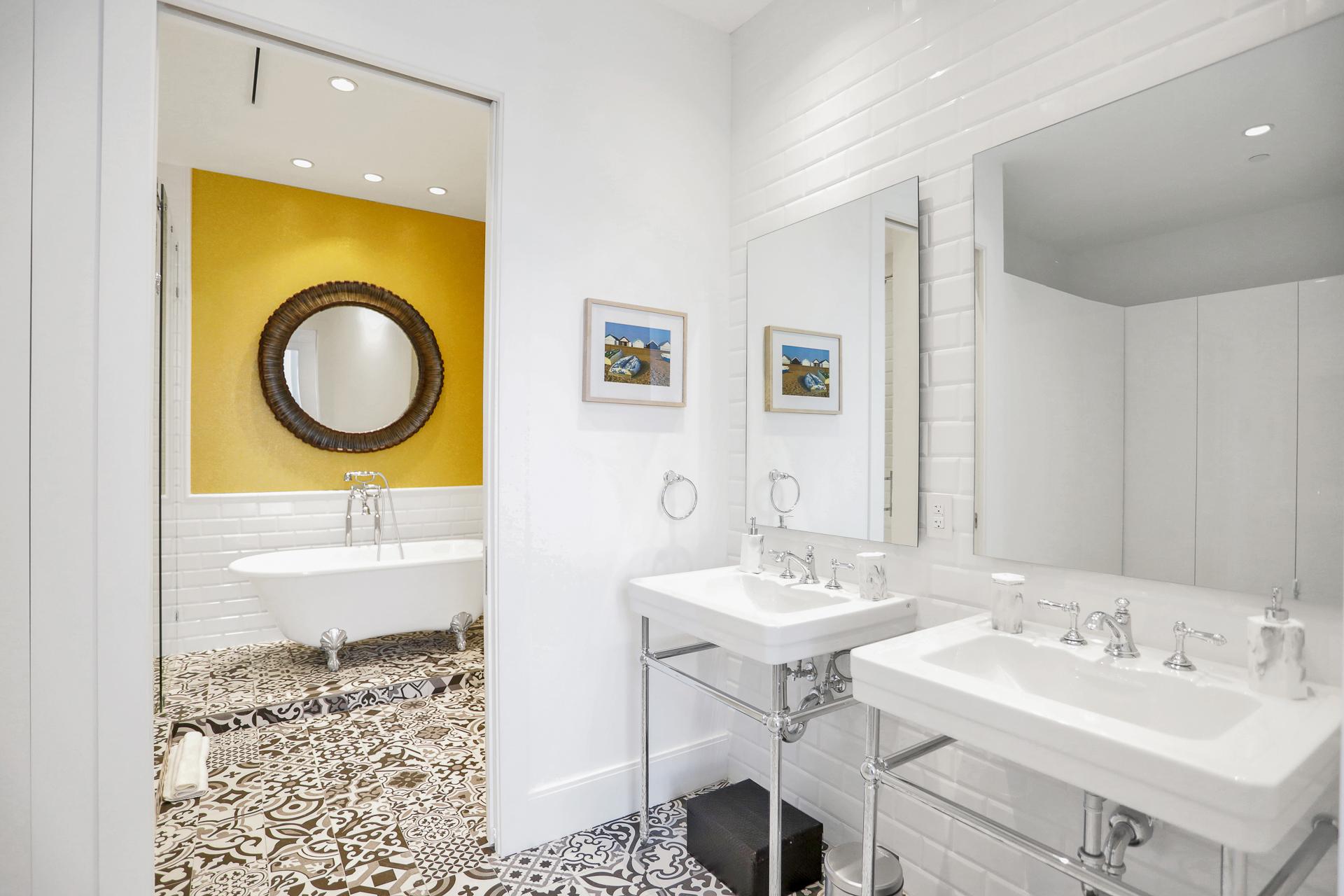 master bathroom with subway tiled walls