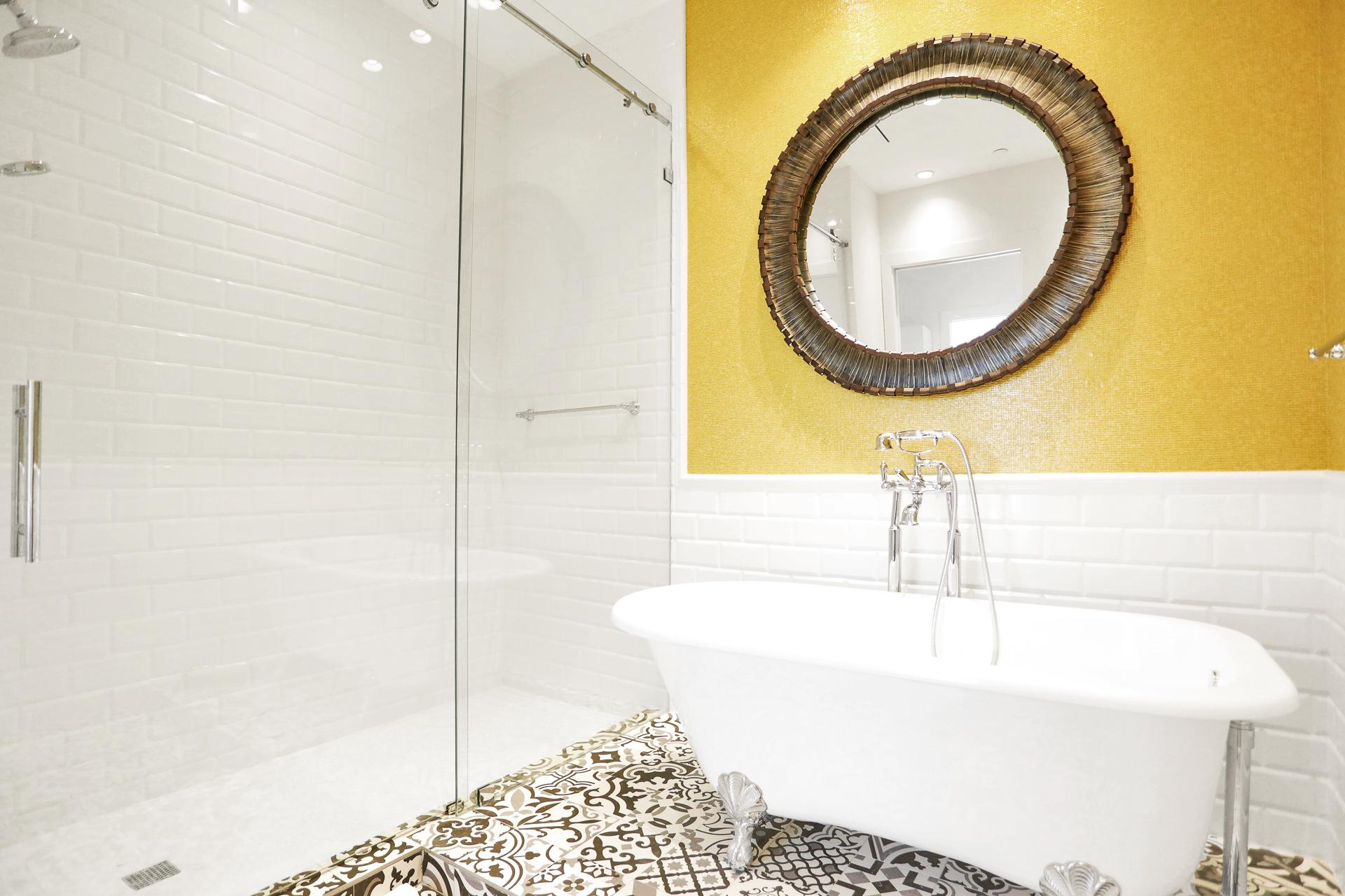 remodeled master bathroom with pedestal tub