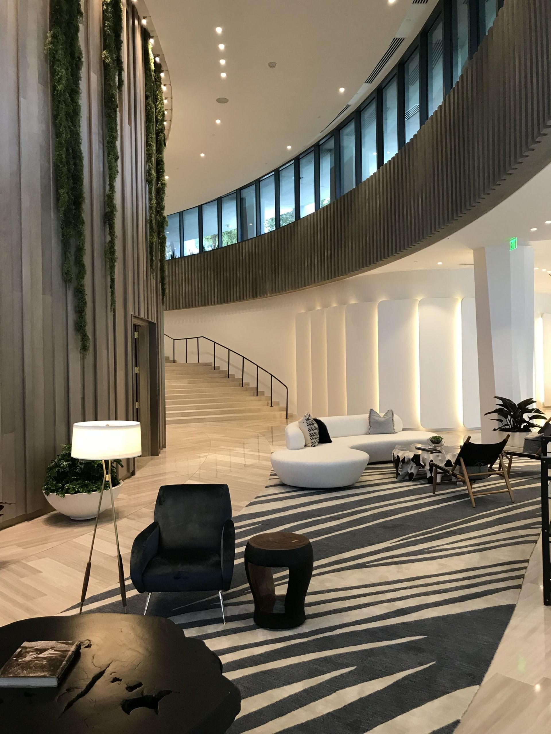 lobby living room and staircase at Park Grove Club Residences