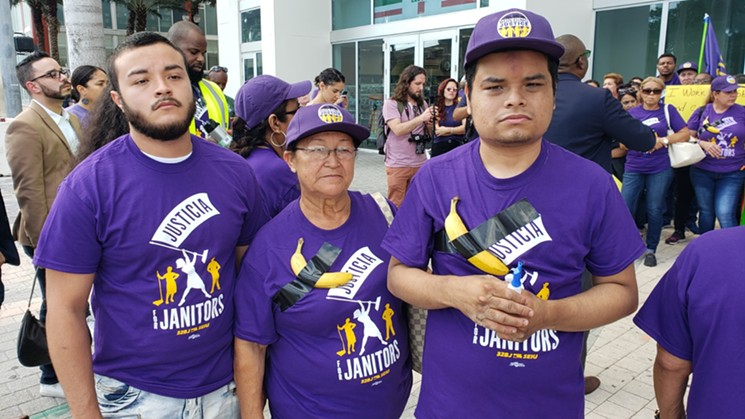 Maria Galindo stands between her sons at Wednesday's protest.