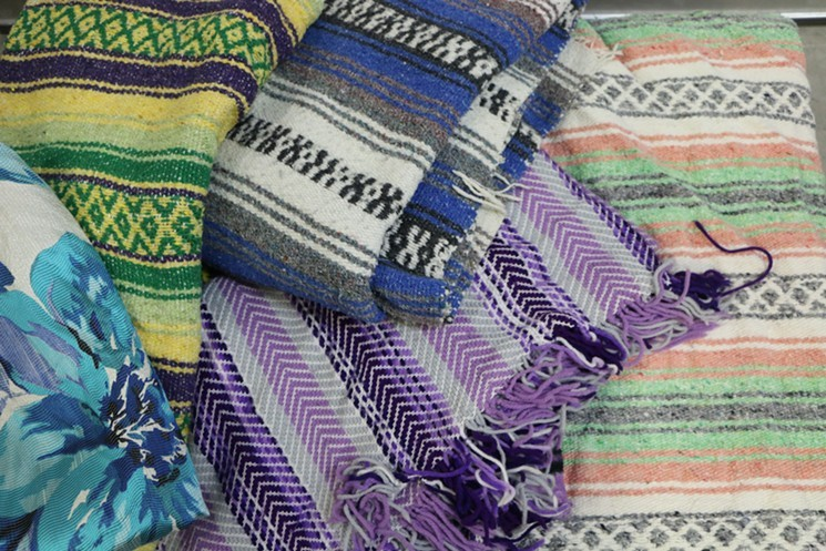 A colorful Mexican throw can go great on the body when Miami's winter temperatures dip and great on the wall as art decor during the rest of the year.