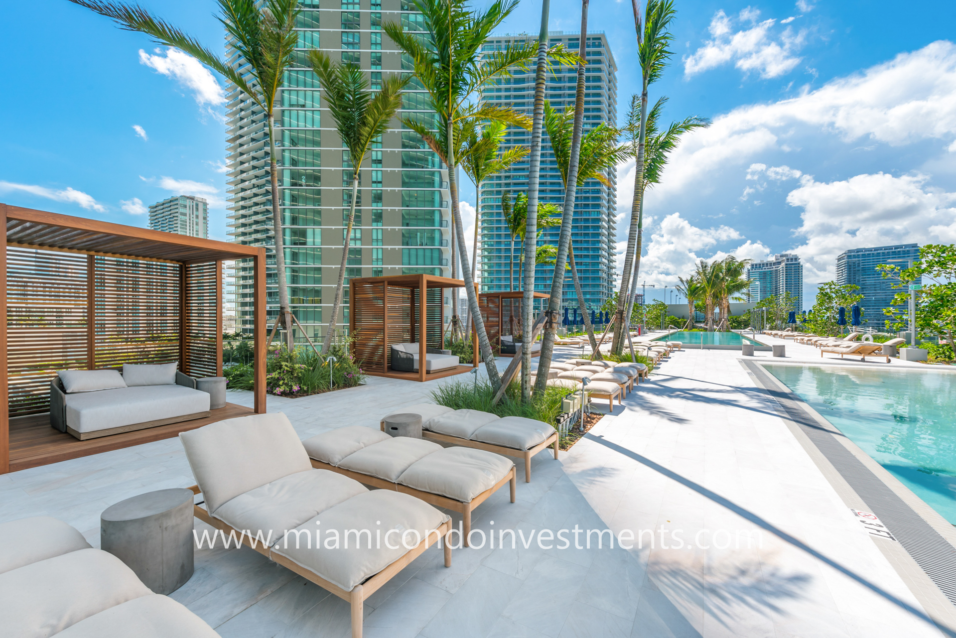 pool deck with cabanas